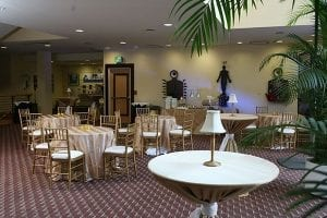 Lobby setup with round tables and chairs